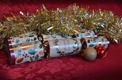 Christmas crackers with ornaments and tinsel Royalty Free Stock Photography