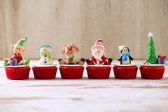 Group of christmas cupcakes on wooden background Royalty Free Stock Images