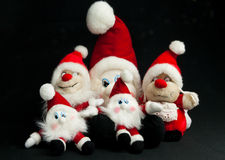 Group of christmas elfs. Christmas toy elfs in different sizes with red hats Stock Photography