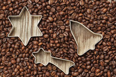 Group of Christmas items in coffee beans. Group of Christmas items in coffee beans on a wooden texture Stock Images