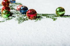 Group of Christmas ornaments in the snow Royalty Free Stock Image