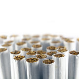 Group of cigarettes against a white background, macro shot Royalty Free Stock Photography