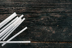 Group of cigarettes on the wood Royalty Free Stock Photo