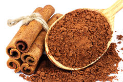 Group of cinnamon sticks and cacao powder, isolated on white background. Stock Photo