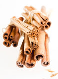 A group cinnamon sticks isolated on white Stock Images