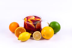 Group of citric fruits with a lemonade carafe on a white background Stock Photography