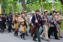 Group of Civil War Reenactors. A company of Civil War reenactors march to Central Park to reenact The Battle of Carthage, Missouri on the 150th Anniversary of Stock Photo