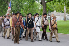 Group of Civil War Reenactors. A company of Civil War reenactors march to Central Park to reenact The Battle of Carthage, Missouri on the 150th Anniversary of Royalty Free Stock Photos