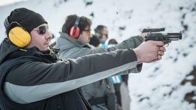 Group of civilian practice gun shooting on outdoor shooting range stock images