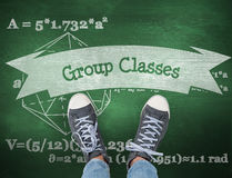 Group classes against green chalkboard Royalty Free Stock Photo