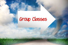 Group classes against road leading out to the horizon Stock Image