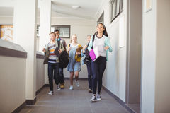 Group of classmate running in corridor. At school stock images