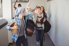 Group of classmate running in corridor. At school royalty free stock images
