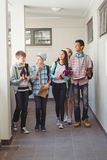 Group of classmate walking in corridor. At school royalty free stock photography