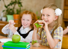 Group of classmates having lunch during break with focus on smil Royalty Free Stock Image