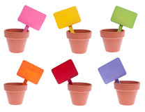 Group of Clay Pots with Blank Colored Signs Stock Image