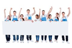 Group of cleaners cheering as they hold a banner Royalty Free Stock Photo