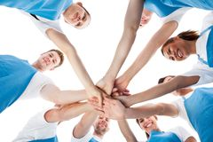 Group of cleaners stacking hands Royalty Free Stock Photos