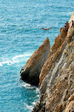 Group of cliff divers in free fly, Acapulco, Mexico. Royalty Free Stock Photo