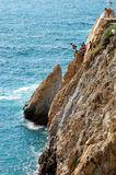 Group of cliff divers in free fly, Acapulco, Mexico. Group of cliff divers in free fly, Acapulco, Mexico Royalty Free Stock Photography