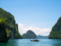 Group of cliff tropical islands and traditional longtail boat in Thailand Royalty Free Stock Photography