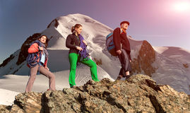 Group of climbers on alpine background Royalty Free Stock Photography