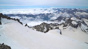 Group of climbers in the Alps. A group of climbers is on the glacier. They climb to the top of the Grand Paradiso in the Italian Alps. 4K stock video footage