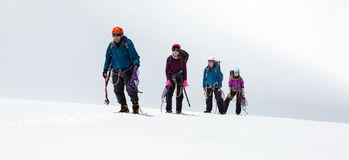 Group of Climbers Approaching to Summit Stock Photography