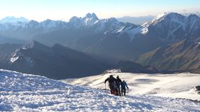 Group of Climbers in crampons coming up to the summit of Elbrus in Caucasus mountains. Snow peak. stock video
