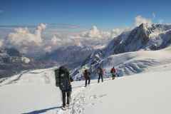 A group of climbers descends to the base camp, Pamir Stock Photos