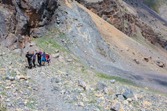 Group of Climbers Hard Walk Stock Image