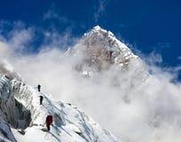 Group of climbers on mountains montage to mount Lhotse. Everest area, Khumbu valley, Nepal Stock Photo