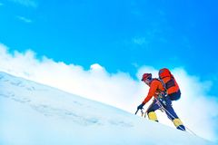 Group of climbers reaches the summit of mountain peak. Success, Stock Images