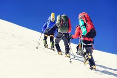 Group of climbers reaches the top of mountain peak. Climbing and. Mountaineering sport. Nepal mountains stock image