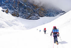 Group of climbers reaching the summit. Royalty Free Stock Photography