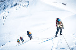 Group of climbers reaching the summit. Extreme sport concept Royalty Free Stock Photography
