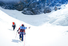 Group of climbers reaching the summit. Nepal Stock Photo