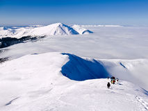 Group of climbers rises by the snow-covered mountain.  stock photos