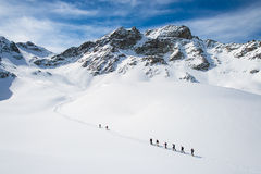 Group of climbers roped to the summit stock photography