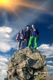 Group of climbers on sharp summit Stock Photo