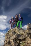 Group of climbers stays on the pointed cliff Royalty Free Stock Image