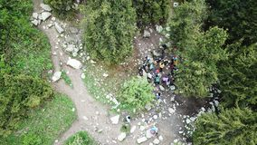A group of climbers stopped in the woods to rest. View from the drone. stock photography