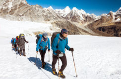 Group of Climbers walking on Glacier in high Mountains Royalty Free Stock Photos