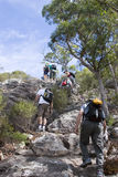 Group climbing Mt Maroon 1. Large group climbing Mt Maroon in Australia Stock Images