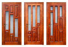 Group of closed wooden entrance doors  on white with paths Royalty Free Stock Image