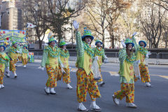 Group of clowns walking and waving Stock Images