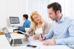 Group of co workers at the office Royalty Free Stock Images