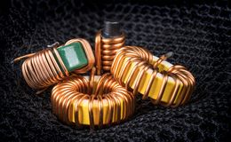 Group of coils with magnetic core and copper winding stock photography