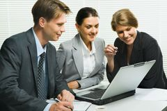 Group of colleagues. Business woman is explaining the correct way of analysis to her colleagues in the office stock photos
