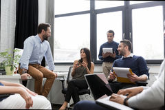 Group of colleagues having a brainstorming session. In conference room Royalty Free Stock Image